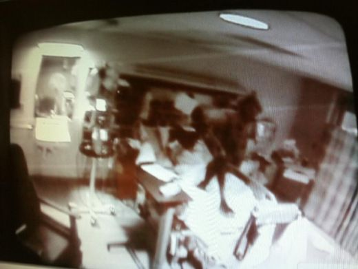 """The above photo recently appeared in the paranormal section of Reddit.com. The OP writes:  """"This picture was taken of a nurse's viewing monitor. On the monitor, this black figure appeared standing on top of the patient who was lying in the bed.The patient died within a few hours of this figure appearing."""""""