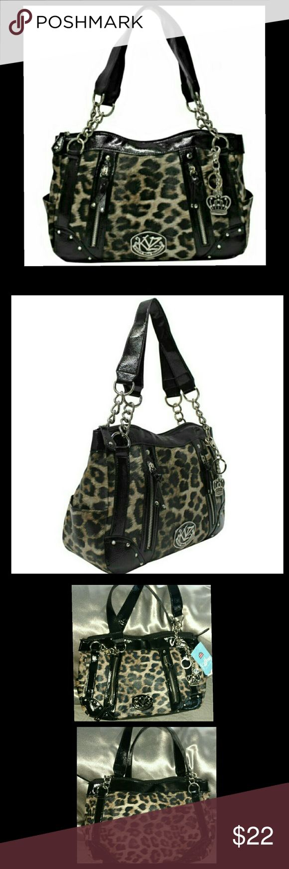 Kathy Van Zeeland Midsize Cheetah Print Satchel Kathy Van Zeeland Midsize Cheetah Print Satchel. NWT   Bag Aprox Dimensions  (W x H) 15in x 9.5In STRAP DROP: 9IN from shoulder to opening of purse. Features:  top zipper closure ,  interior back wall zip pocket. And 2  interior wall side by side slide in pockets Double Handles 4 Compartment on outside  2 small zip pockets and 2 slide in pockets on left and right side of bag Kathy Van Zeeland Bags
