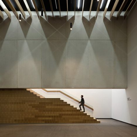 Theatre in Huelva, Spain. Timber partitions, staircases and benches furnish the lobby, whilst the auditorium has a timber floor.