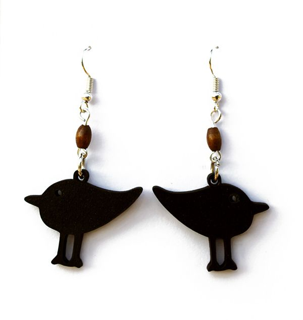 These handmade wooden earrings have the looks and charm of a fat bird. They have a matte black finish and are silver plated (safe for those who are sensitive to nickel).  Made by Dare to Dream, based in the Garden Route of South Africa.  www.handmadeline.co.za