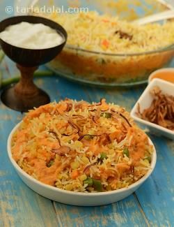 A concoction of rice, dal, mixed veggies, saffron and fried onions, is layered with a rich gravy made with onion paste, and baked in an oven. This is a relatively easy-to-make main course, but the effect is grand because baking creates a 'dum' effect in the vegetable and lentil pulao.