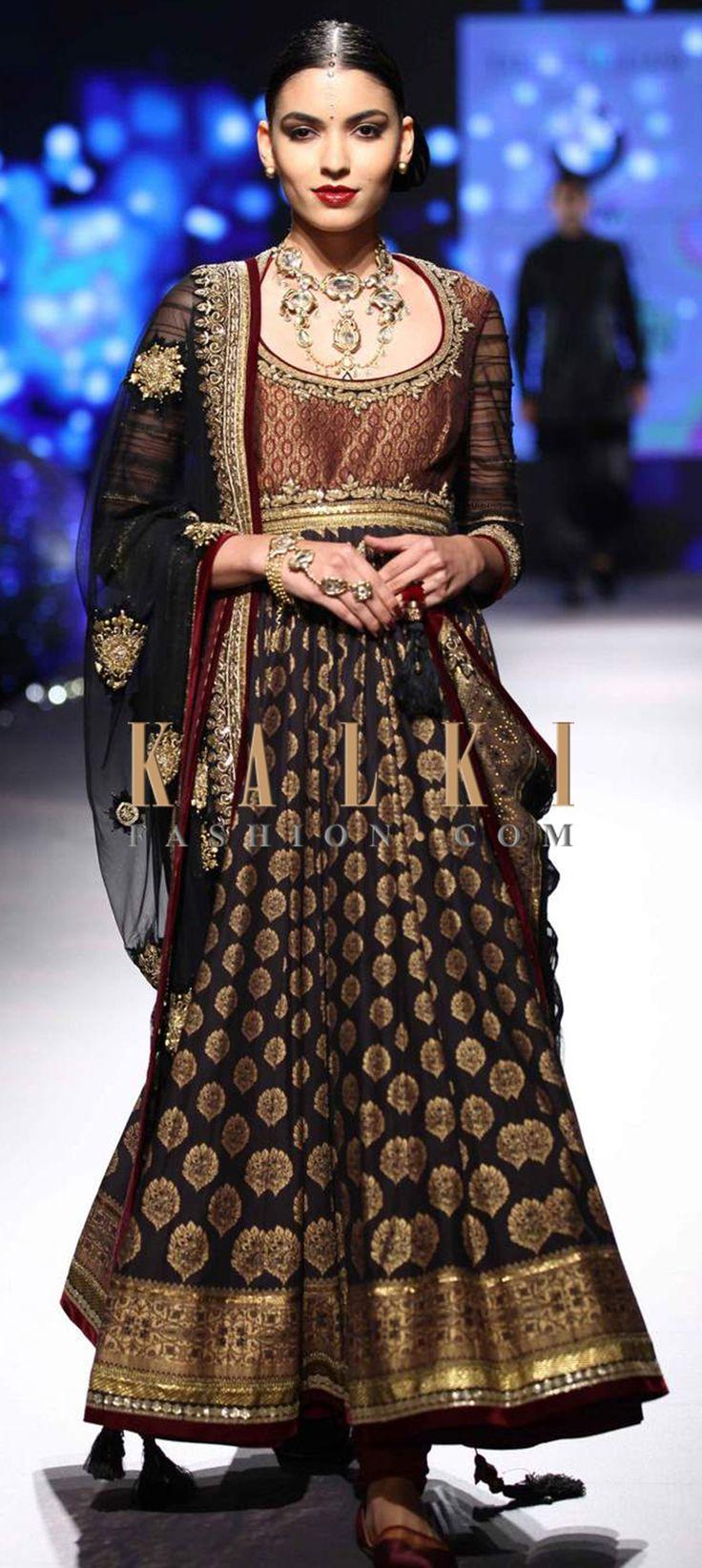 Click on the following link - http://www.kalkifashion.com/designers/tarun-tahiliani.html