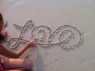 beautiful way to write love on the beach! Wedding pics