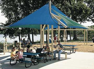 CoolToppers® Full Sail by Landscape Structures Inc. is our most popular shade structure, providing shade on the playground or park.
