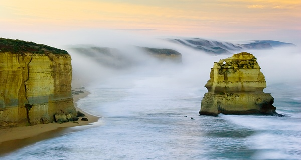 Dawn mist cascading over the cliff. Gibson Steps Beach as shot from the 12 Apostles near Port Campbell Victoria as shot by David Hibbert