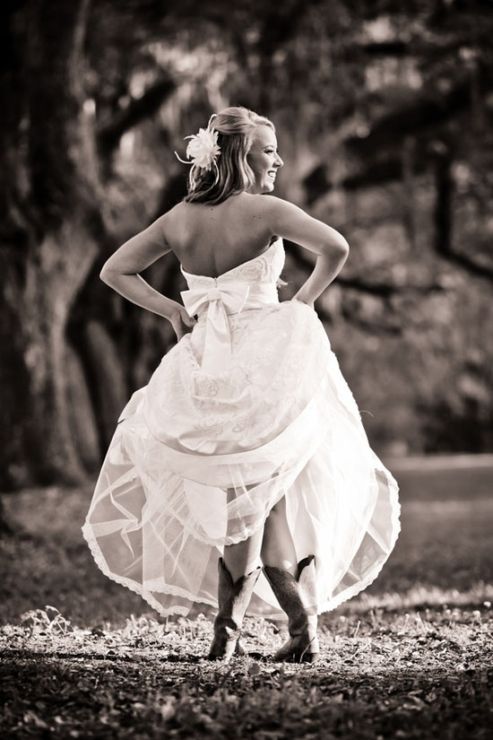 Whitney wears a custom Violet gown by Modern Trousseau Charleston for her Low Country wedding. We love her cowboy boots yall!    Image courtesy of Richard Bell Photography