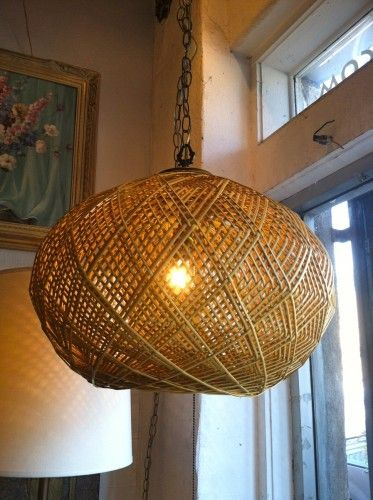 This 1970s large wicker swag light is hip and sophisticated at the same time.