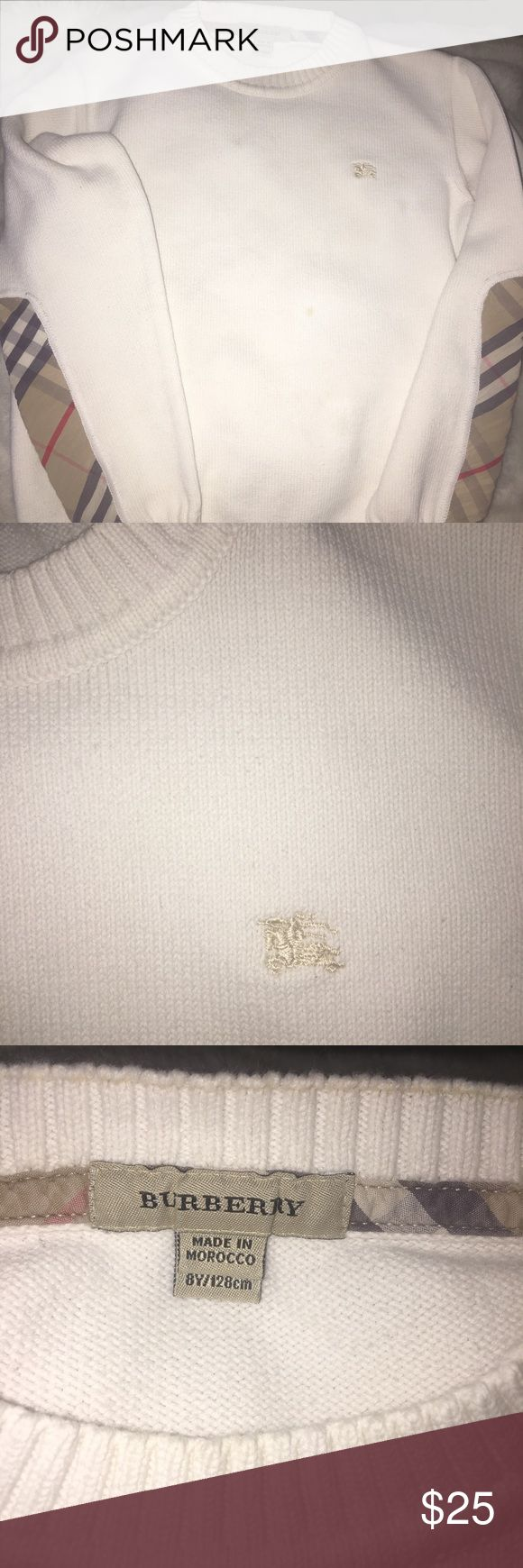 Used Burberry Big Kids Sweater Size 10 It is still in good condition, no holes or rips but I did store it for about a year and I noticed a few super light stains. Perhaps some Oxy Clean or a Clorox magic marker can remove, price based because of that. Burberry Shirts & Tops Sweaters