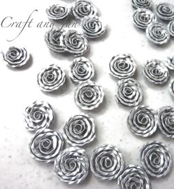 Tutorial - Make roses from coffee capsules, italian site but has lots of pics