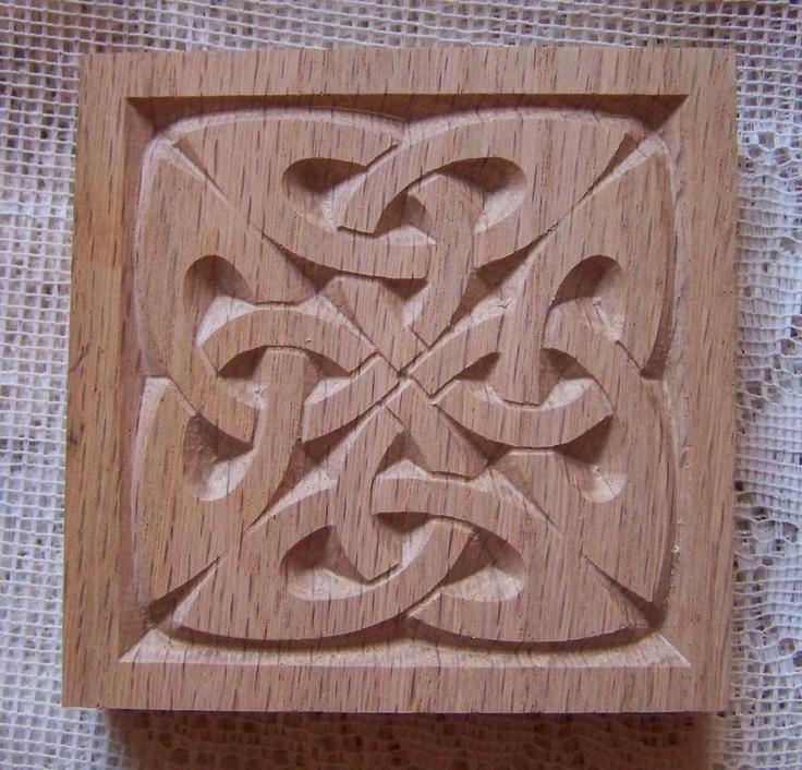 Carved wood celtic style rosette corner block in red oak