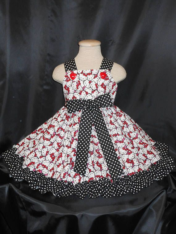 Hello Kitty, Girls Dress, Custom Boutique, Hello Kitty Dress, Unique, Handmade Hello Kitty Dress, Birthday, Pageant, Hello Kitty Princess dress This dress is beautiful, Trimmed in black and white polka dots. NOTE, size of polka dots may vary due to availability of fabric... Your Little Princess will be the Bell of the Ball with this lovely, Hello Kitty Dress....A true showstopper! Gathered waist for those that love to spin and twirl.. Fully lined bodice and top stitched with black ric rac...