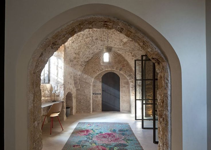 Renovated house in the Jaffa, Tel Aviv, by Pitsou Kedem with exposed vaulted ceilings, stone walls and views across the Mediterranean Sea.