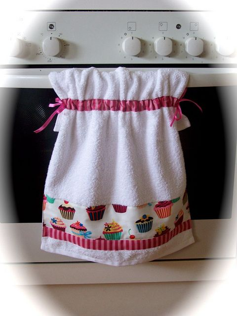 Pretty tied oven rail hand towel for the cupcake decor kitchen.
