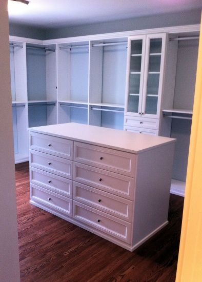 Master Closet Design Ideas :  I'd replace two sections of bars with two chests-of-drawers, instead of the random island.