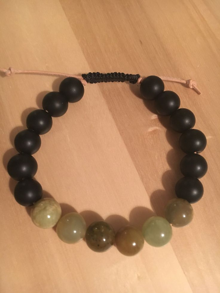 A personal favourite from my Etsy shop https://www.etsy.com/uk/listing/503878139/mens-onyx-and-jade-on-leather-expanding