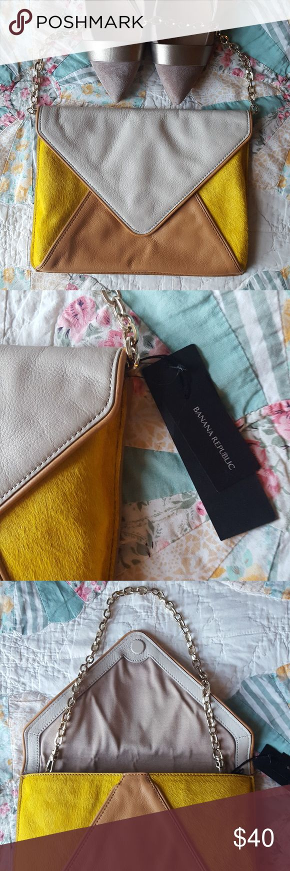 BR Leather Colorback Envelope bag w/Calfskin NWT Another clutch that sat in my closet, NWT. The back is the same color as the tan section. The yellow is real calfskin. Perfect size for going to work, going out, or a concert! Banana Republic Bags Clutches & Wristlets