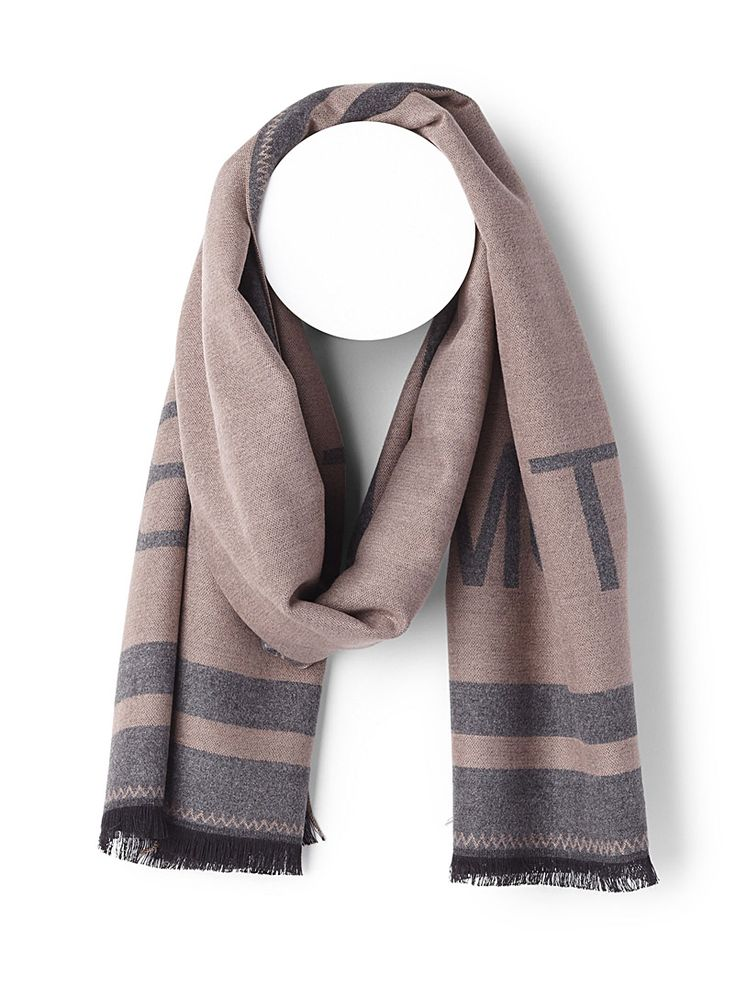 Only at Simons   A scarf that lets you show off your boyish side with pride   Ultra soft and delicate weave for pure comfort   Contrasting striped trim   Thin fringes at the ends   172 x 61 cm