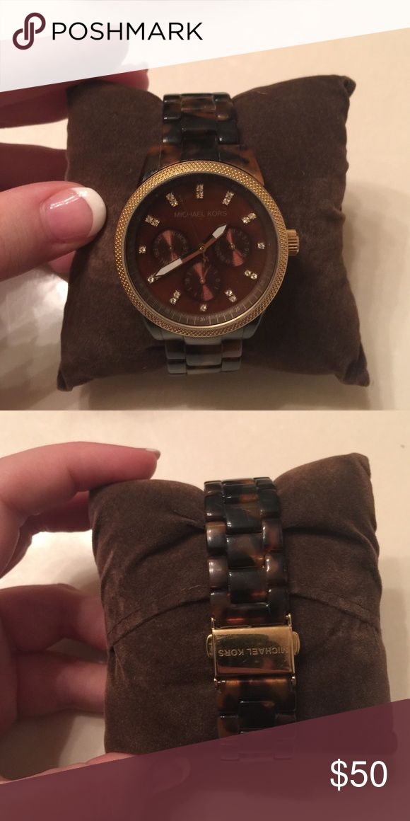 Michael Kors Tortoise Watch MK5038 In excellent condition! Loved how lightweight this watch is. Needs a new battery, but fossil will replace for $10. I believe it has all links intact (I have big wrists). No box or Watch pillow. Michael Kors Accessories Watches