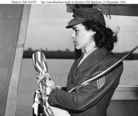 USMC Sergeant Lena Basilone, widow of Medal of Honor recipient USMC Gunnery Sergeant John Basilone, getting ready to christen the U.S. Navy ship the USS Basilone (DD-824), December 21, 1945,prepares to christen the destroyer at the Consolidated Steel Company Shipyard, Orange, Texas, on 21 December 1945 ~