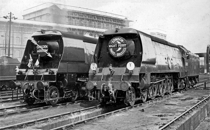 The Night Ferry (with what looks like un-rebuilt Merchant Navy 35028 Clan Line) and another possible Merchant alongside (identity not known) in full Golden Arrow regalia ready for duty!