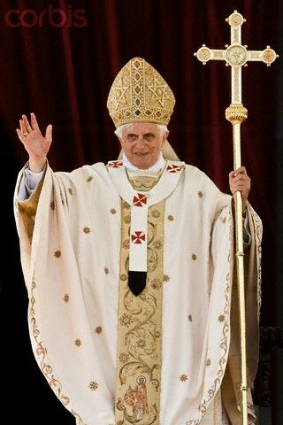 Benedict XVI in a cream, bespeckled chasuble, ferula in hand.
