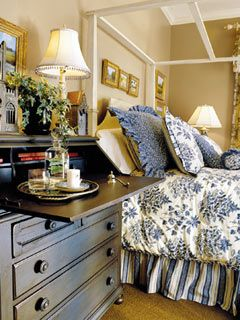 Guest room idea (Southern Living)...Use a secretary to double as a dresser and a nightstand.  Looks sooo inviting with books, water tray, candle and snuffer.