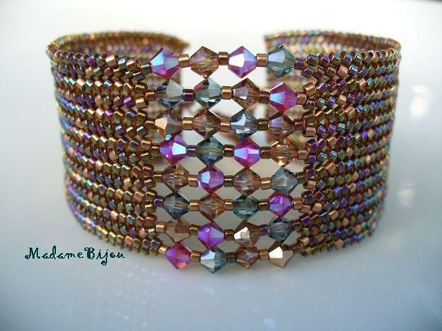 beautiful; looks like herringbone but wonder how the larger beads are put in??