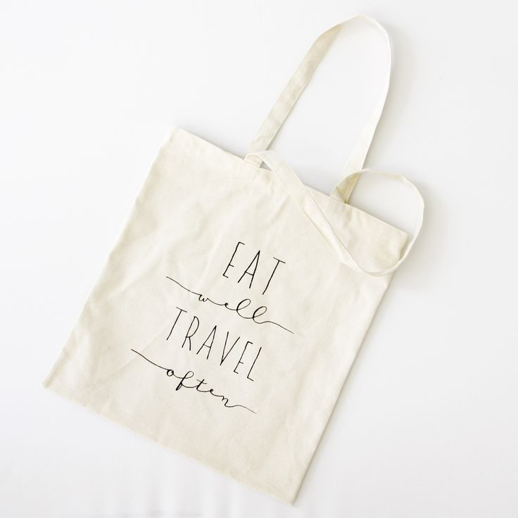 """Sturdy canvas tote, screen printed on both sides with our """"Eat Well Travel Often"""" design. Use it to carry your Farmer's Market finds, or as a carry along while"""