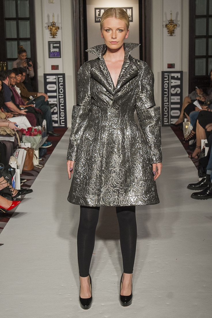 "Lenie Boya ""Dramatique"" Collection at London Fashion Week S/S 2016 Haute Couture. Metallic Silver brocade bubble coat, with slit futuristic sleeves and sculptured 3d calla lily lapel collar."