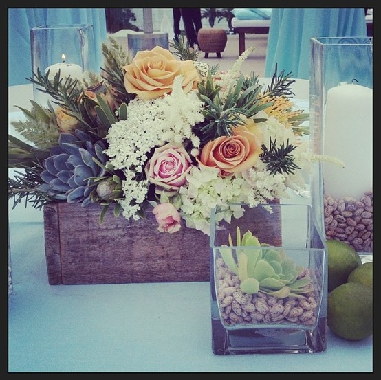 Beautiful soft rustic Mexican centerpieces for an oceanfront rehearsal dinner.  Thanks, Adrienne Smith Floral Design!  beach wedding flowers