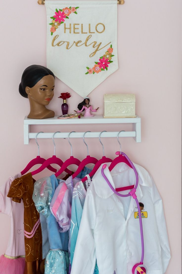 A painted Ikea spice rack turned upside down is perfect for creating a fun little dress up area. | The Home I Create