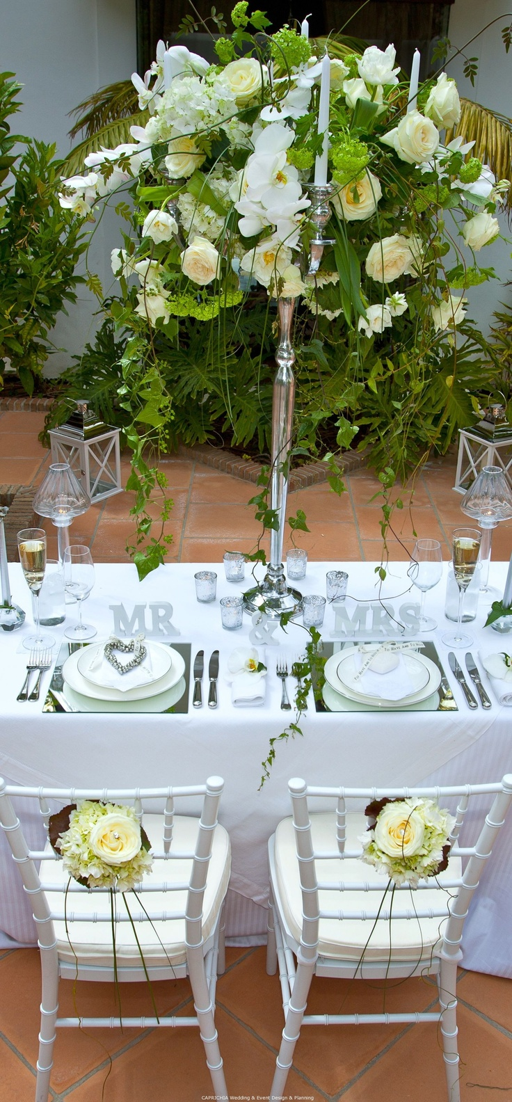 Signature Mr & Mrs Wedding table by caprichia.com Weddings & Occasions (Marbella) Flowers by L&N Floral Design.