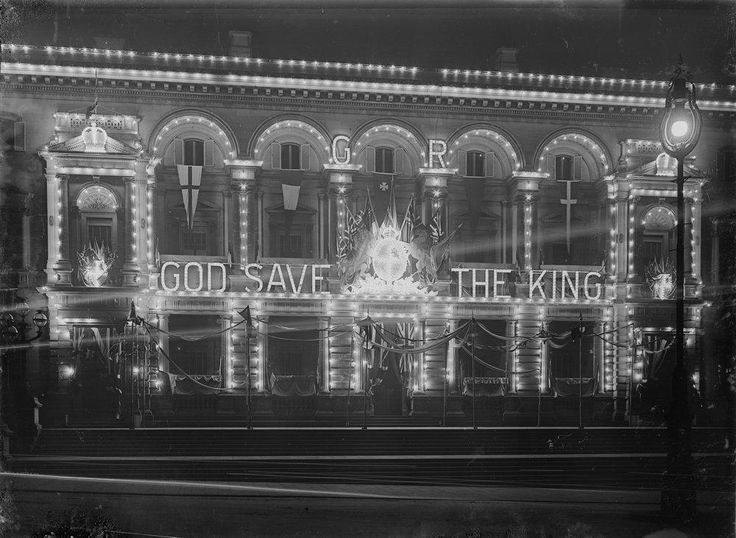 """Treasury Building illuminated at night with the message """"God Save the King"""". Image Source: State Library of Victoria"""