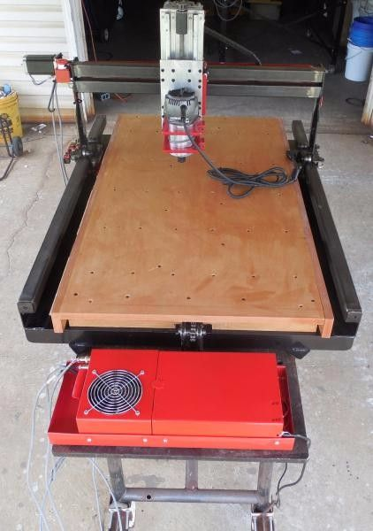 CNC Router Table by acourtjester -- Homemade 2'x3' CNC router table fabricated from wood and steel. Utilizes USBCNC and equipped with a 2.5 HP router. http://www.homemadetools.net/homemade-cnc-router-table-5