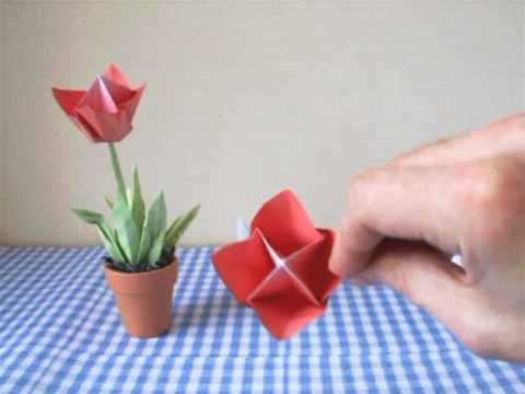 Origami flower arrangement with one tulip in a little pot. Much more origami on http://www.joostlangeveldorigami.nl/ and this is the adres for diagrams of th...