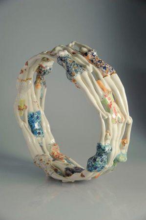 Michaela  Klockner Balancing Act 1 - 2013 Hand built, porcelain, slip cast, glaze, tissue paper, decals and gold lustre 11 x 32cm