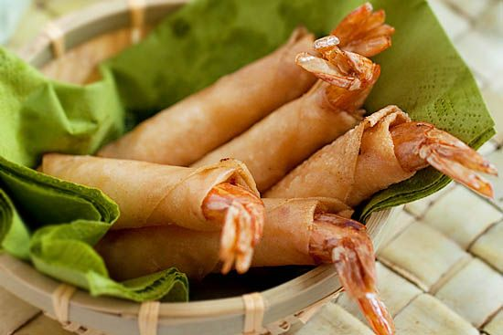 Firecracker Shrimp is a shrimp appetizer wrapped with spring roll wrapper and deep-fried. Easy firecracker shrimp recipe that is sure to please.