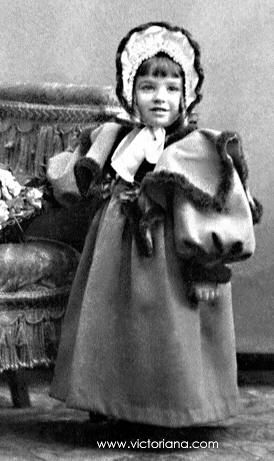 Victorian clothing 1890 jacket snug at waist and flared out, leg of mutton sleeves , bertha ruffed edge over sleeves, matching hat