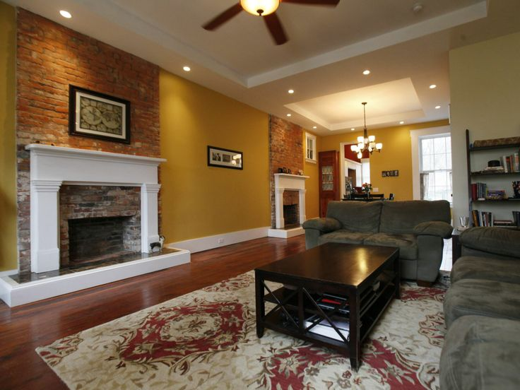 The Living Room Features Exposed Brick Fireplaces With Matching Wood  Mantels That The Couple Bought At