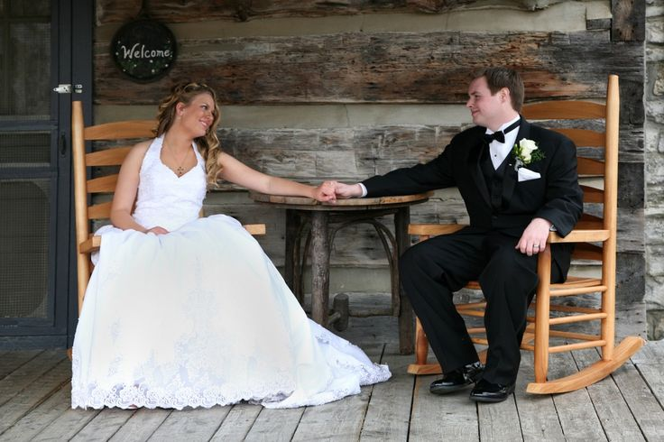 Bride and groom posing on the porch for their Gatlinburg cabin wedding