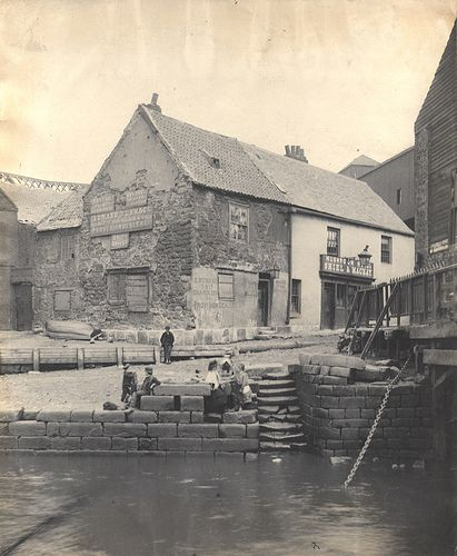 A photograph of the Mushroom Hotel taken in 1886. To the left of the pub is the premises of Edward Nunnage Ship Chandlers and Provision Dealers. This was where the ferry would take people from newcastle to gateshead, one of many ferries running on the river because of the lack of foot bridges at that time.