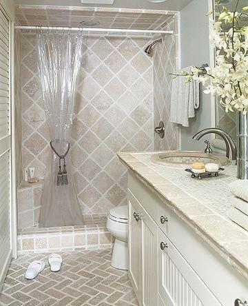 Small Bathroom 9: Luxurious Tiles. note corner bench, basket-weave floor travertine tiles on shower walls.