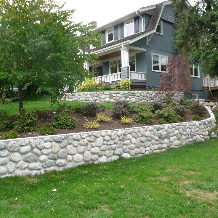 River Rock Retaining Wall But With Bigger Stones More
