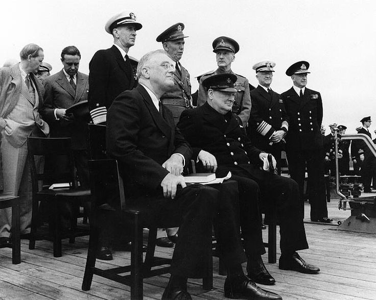 Roosevelt and Churchill at the Atlantic Charter Conference, Placentia Bay, Newfoundland, 10-12 Aug 1941; Hopkins, Harriman, King, Marshall, Dill, Stark, and Pound behind them