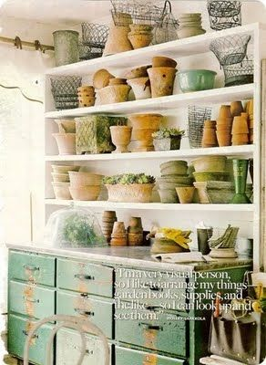LOVE this Hutch...perfect place to store all the terra cotta pots during a snowy winter.