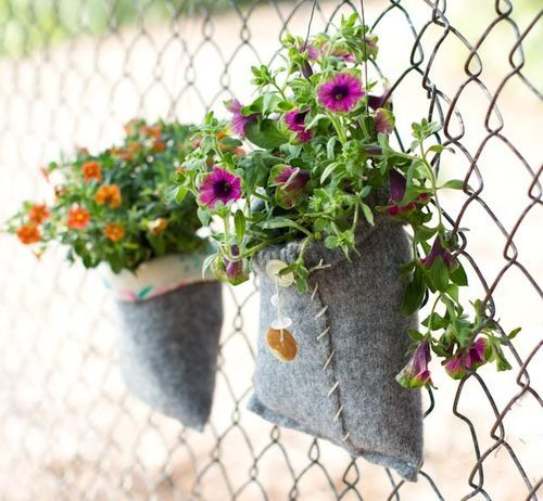 Chain link fence with hanging flower pots chain link - Flower pots to hang on fence ...