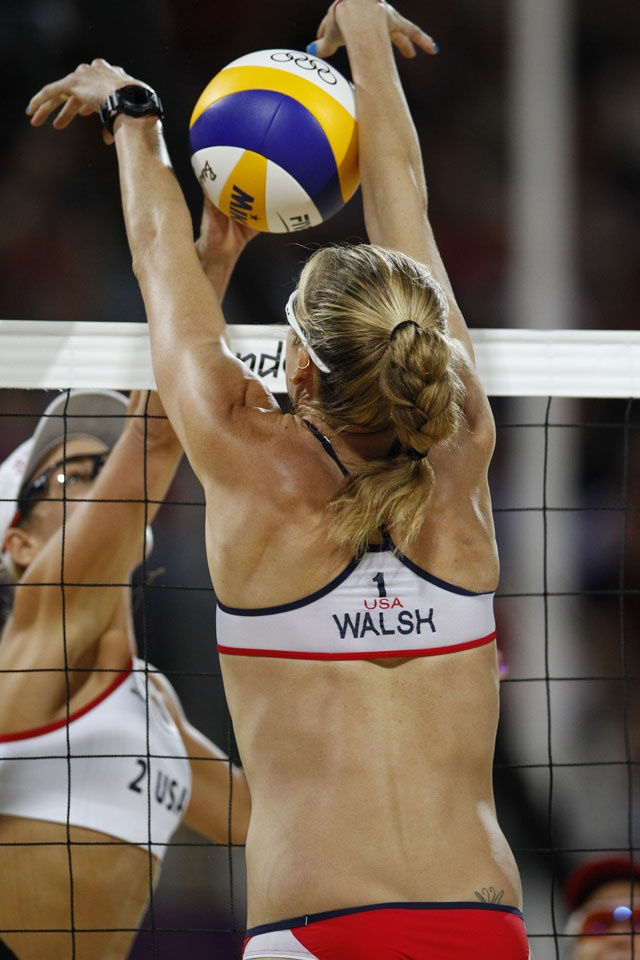 London 2012 - Kerri Walsh Jennings blocks an attack from Jennifer Kessy. Both teams from USA compete for gold in women's beach volleyball.  IOC/Jason Evans