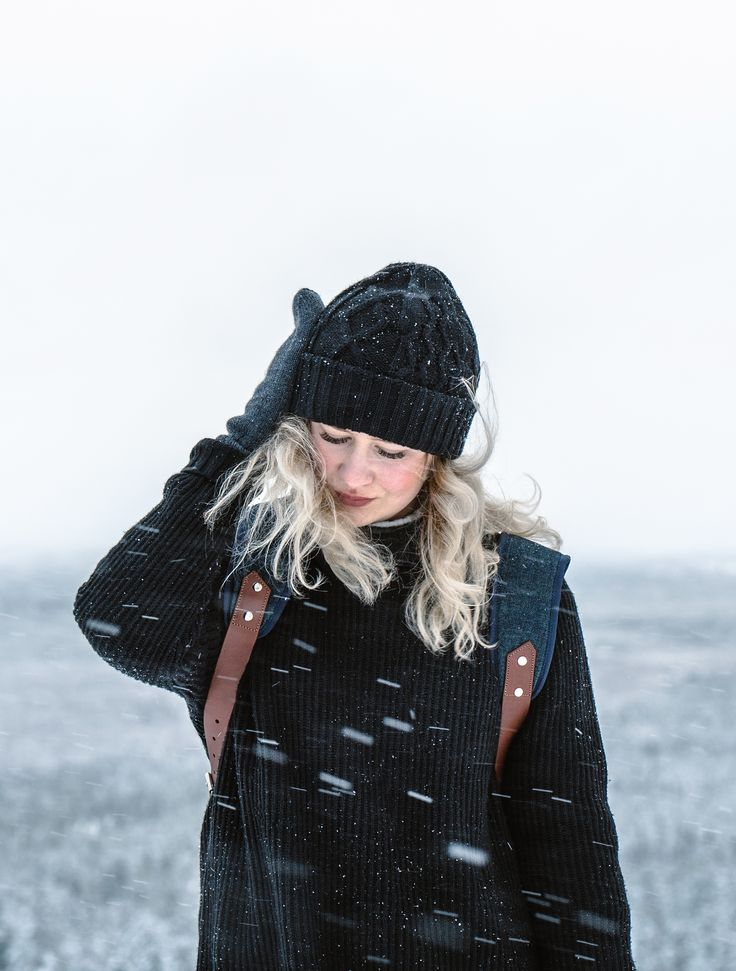Waiwo beanie of merino wool and Waris backpack of recycled materials by COSTO. Photograph by Sanni Vierelä in Finnish Lapland