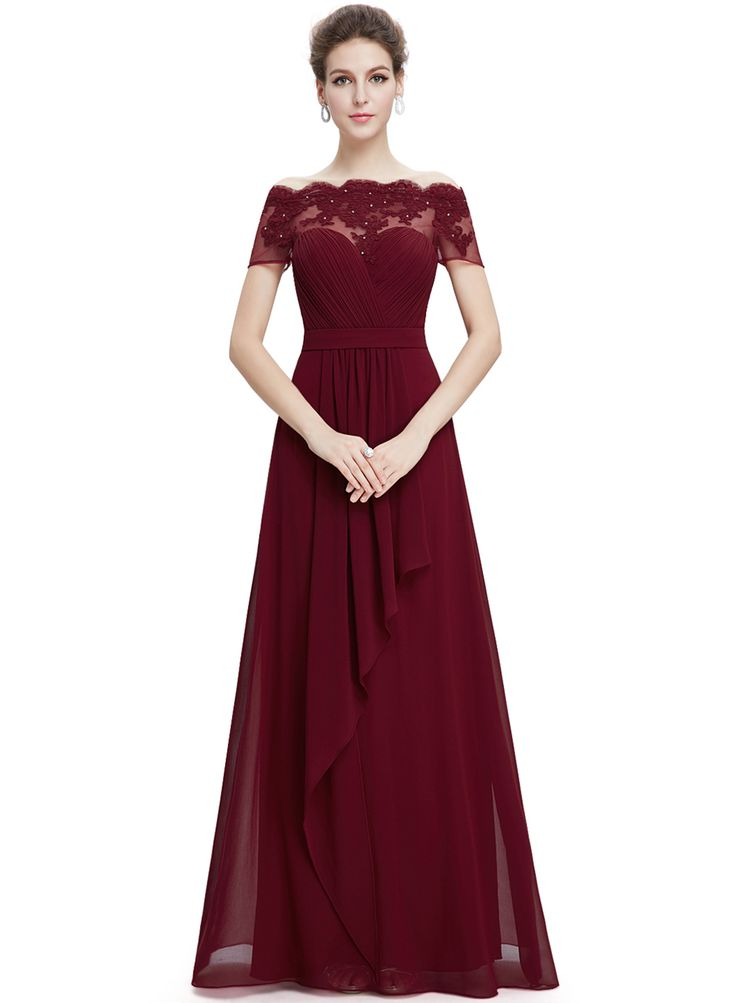 The dress is featuring slash neck, short sleeve, back zipper closure, floral lace panel, solid color and ankle length.