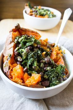 The ultimate vegan loaded sweet potato - packed with kale, black beans and topped off with a homemade green goddess dressing. Perfect for a quick and easy weeknight meal.